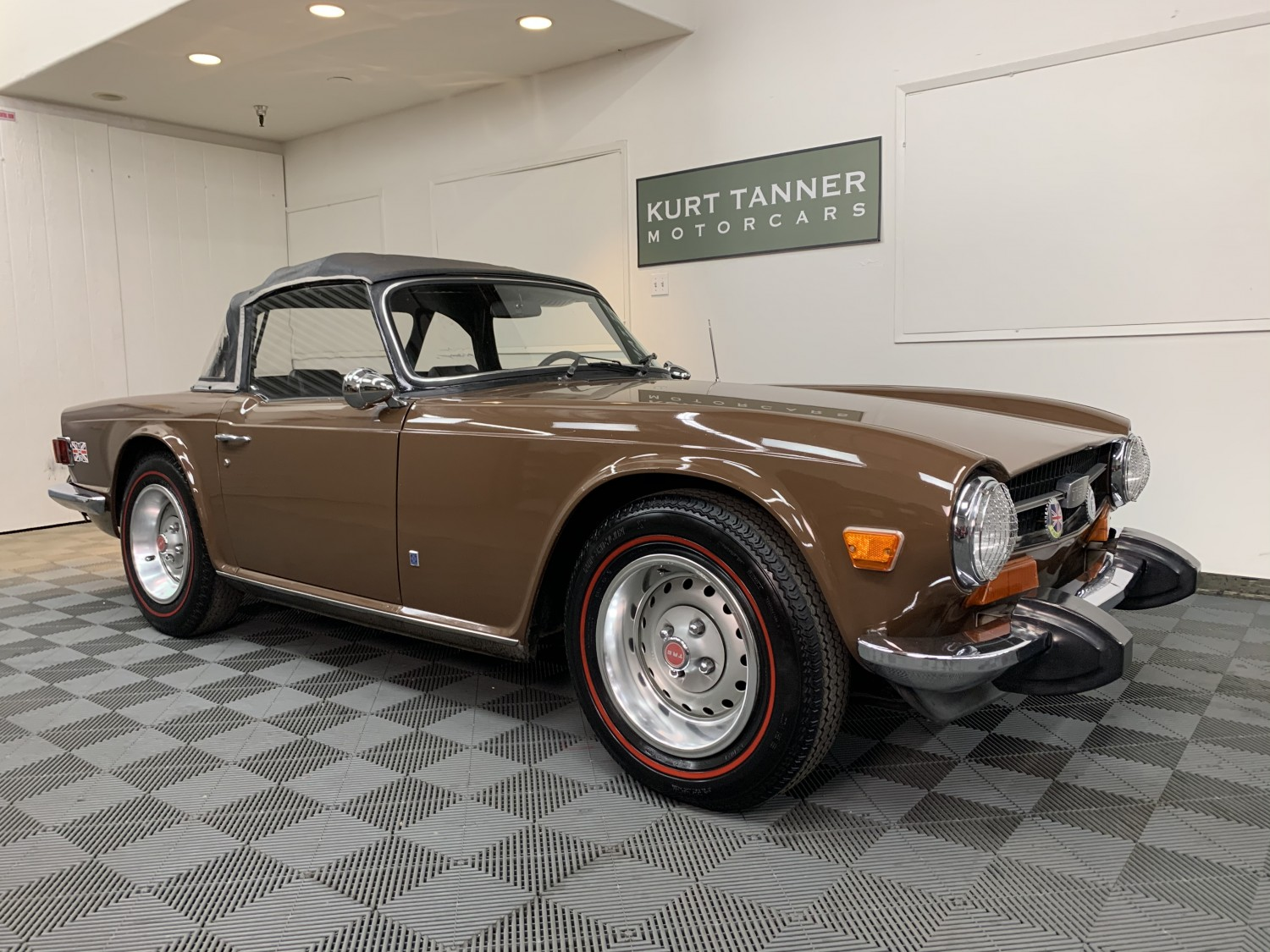 1974 TRIUMPH TR-6 CONVERTIBLE. ORIGINAL PAINT, SIENNA BROWN WITH BLACK TRIM, SOFT TOP, AND TONNEAU COVER. 4-SPEED, STANDARD WHEELS. REDLINE TIRES.  EXCELLENT ORIGINAL WITH 67,318 MILES.