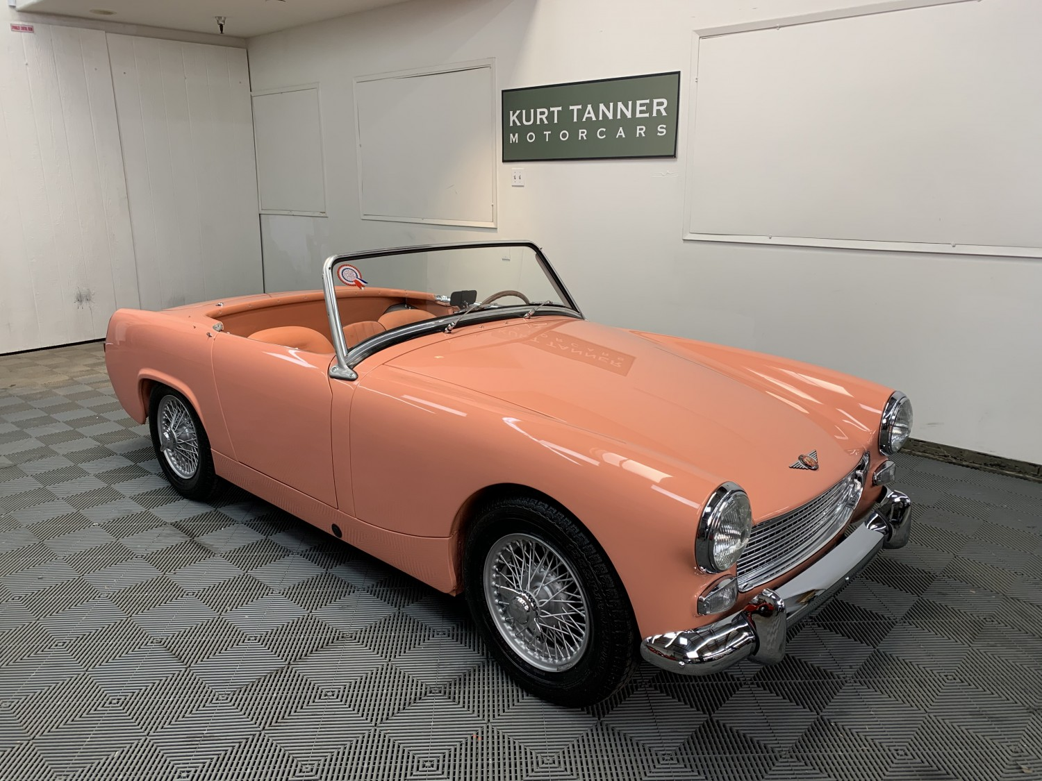 1963 AUSTIN HEALEY SPRITE MK2 ROADSTER. SALMON WITH MATCHING TRIM. GRAY CARPETS, TOP, TONNEAU COVER. 4-SPEED. WIRE WHEELS. HOT 1275cc ENGINE. EXQUISITE GROUND-UP RESTORATION. SUPERB LITTLE CAR.