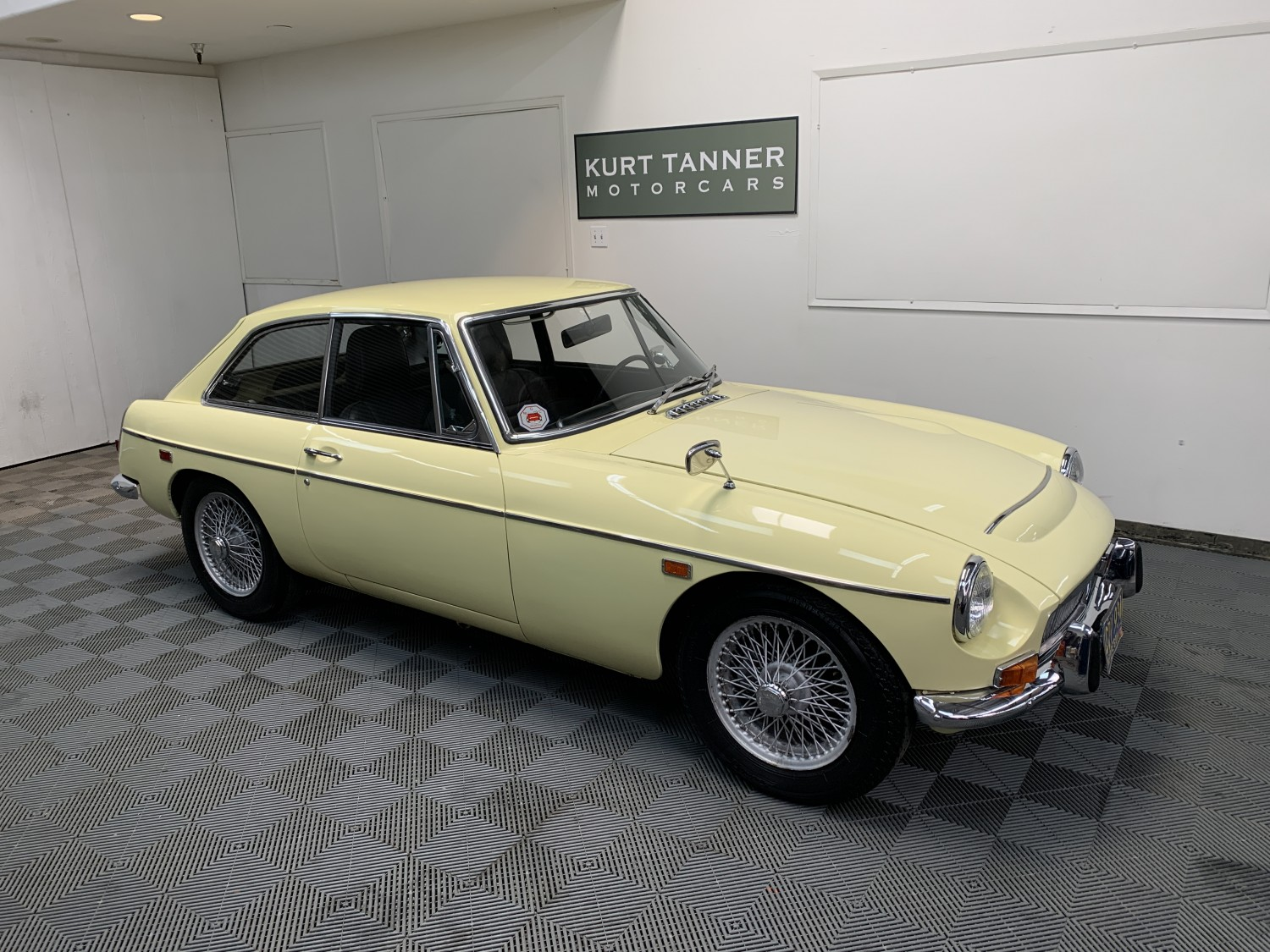 1969 MGC GT SPORTS COUPE. PRIMROSE YELLOW WITH BLACK INTERIOR. 2.9 LITERS, 6-CYLINDER. 4-SPEED WITH OVERDRIVE GEARBOX. WIRE WHEELS. SUPERB, WELL-PRESERVED ORIGINAL CAR SHOWING 31,932 MILES.
