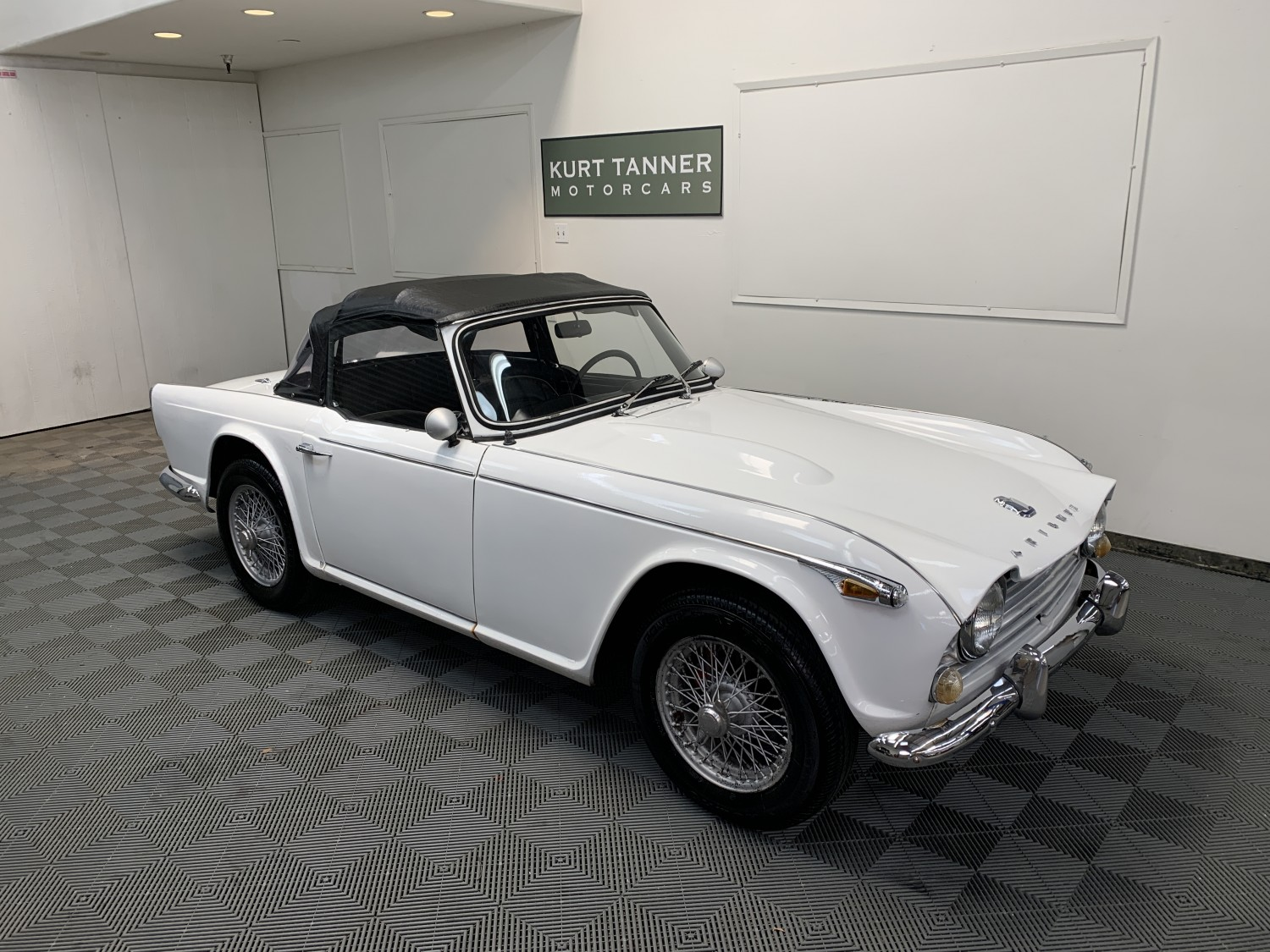 1967 TRIUMPH TR4A SPORTS CONVERTIBLE. SOLID AXLE. WHITE WITH BLACK TRIM AND WEATHER EQUIPMENT. 4-SPEED, 60-SPOKE PAINTED WIRE WHEELS. GOOD DRIVER.