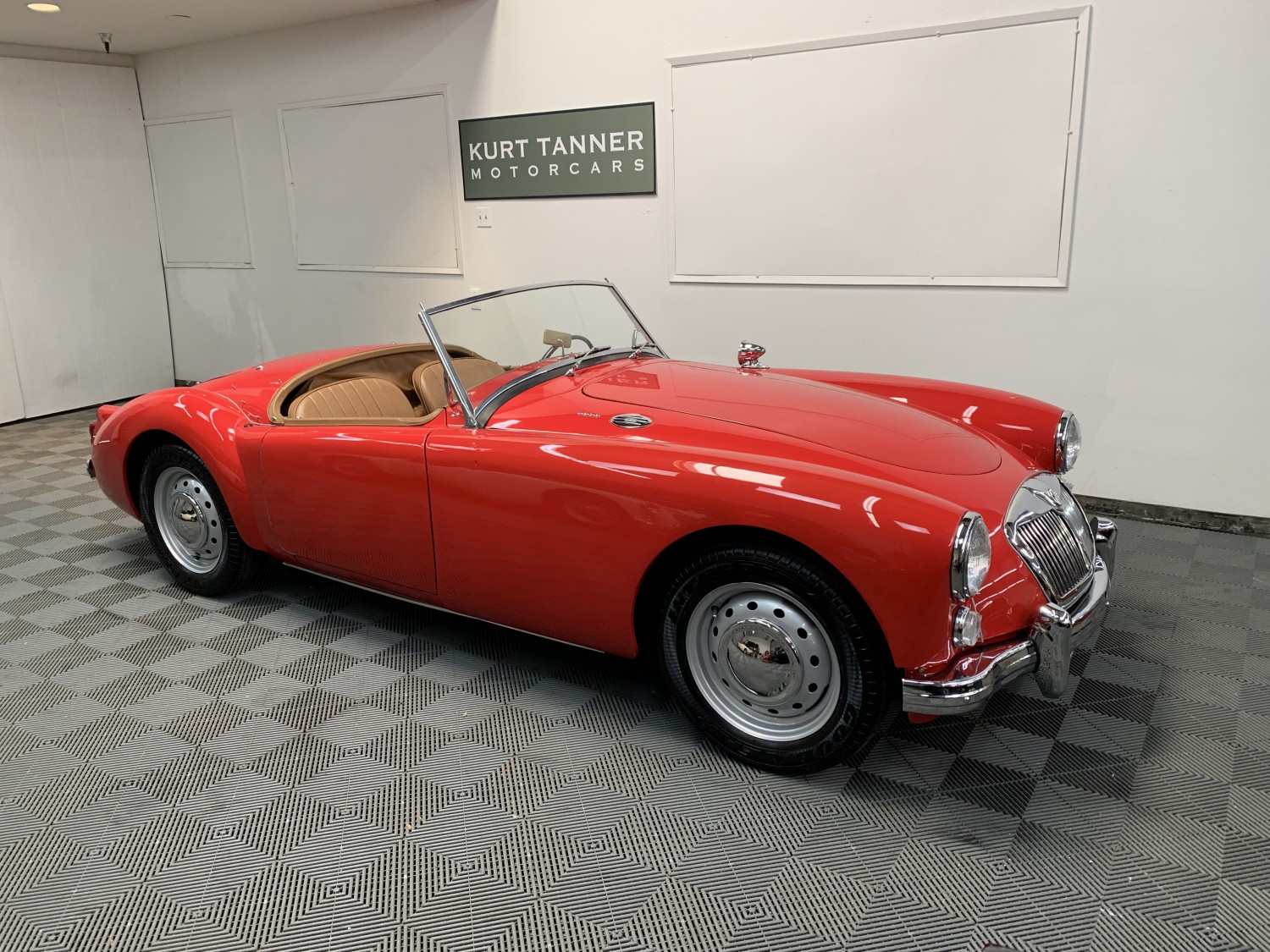 1960 MGA 1600 ROADSTER. CHARIOT RED WITH BEIGE TRIM. BLACK CARPETS. BEIGE TONNEAU COVER. 4-SPEED, DISC WHEELS, 1800cc ENGINE. NICE RESTORATION. SUPERB DRIVER.
