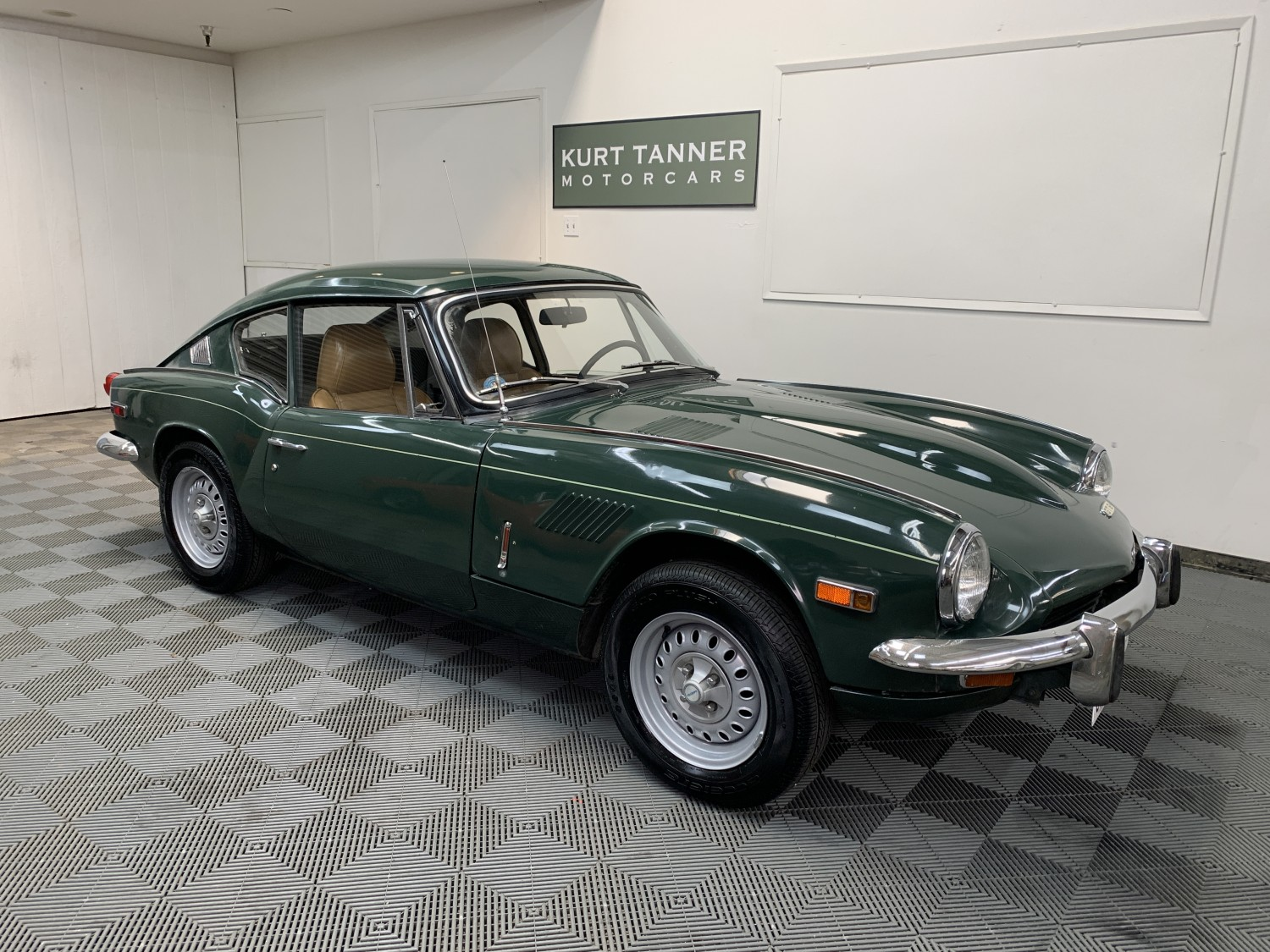 1970 TRIUMPH GT6+ SPORTS COUPE. LAUREL GREEN WITH BLACK TRIM, BEIGE LEATHER SEATS. 4-SPEED, STEEL WHEELS. WELL-PRESERVED CA CAR WITH 80% ORIGINAL PAINTWORK. GOOD DRIVER. SHOWS 46,428 MILES.