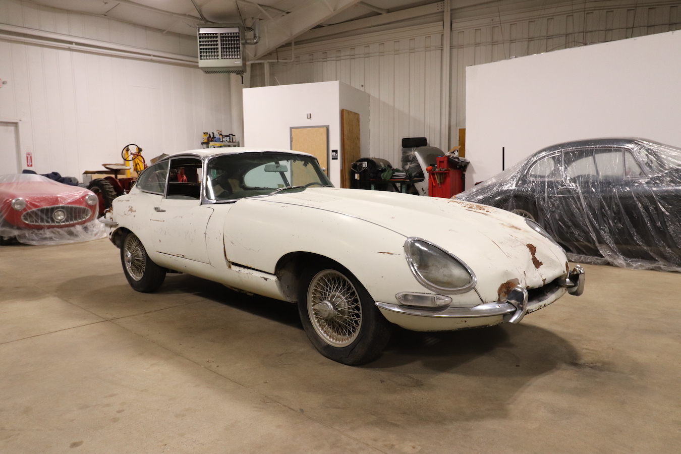1967 JAGUAR E-TYPE XKE COUPE. SERIES ONE. 4.2 LITERS. COVERED HEADLAMPS, TRIPLE CARBS. WHITE WITH BLACK TRIM. 4-SPEED, WIRE WHEELS. GOOD CAR FOR RESTORATION.