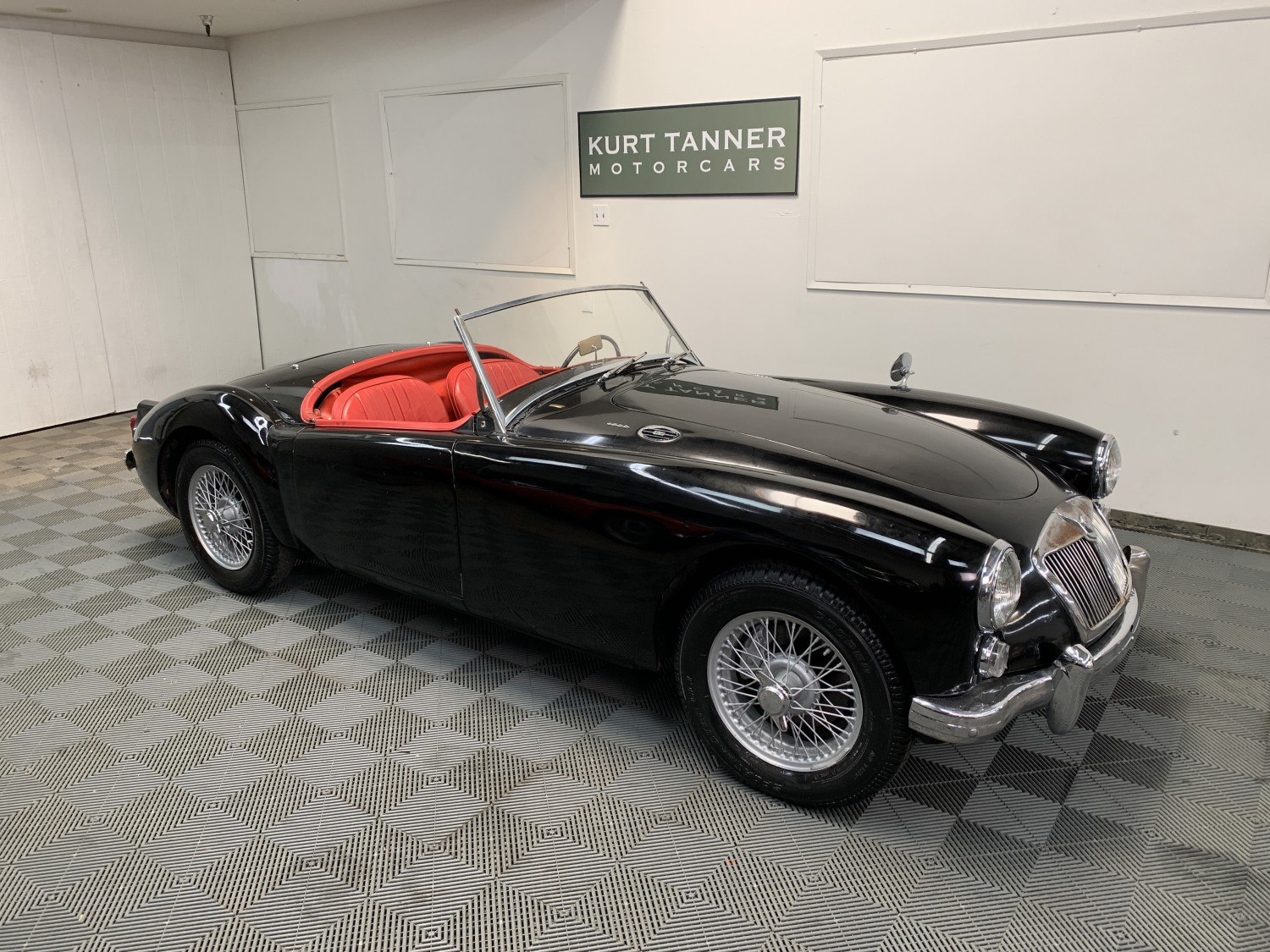 1960 MGA 1600 MK1 ROADSTER. BLACK WITH RED TRIM. BLACK TOP, GRAY TONNEAU AND SIDESCREENS. 4-SPEED, WIRE WHEELS. SUPER, WELL-PRESERVED LARGELY ORIGINAL CAR. 62,519 BELIEVED ORIGINAL MILES. SUPER DRIVING CAR.