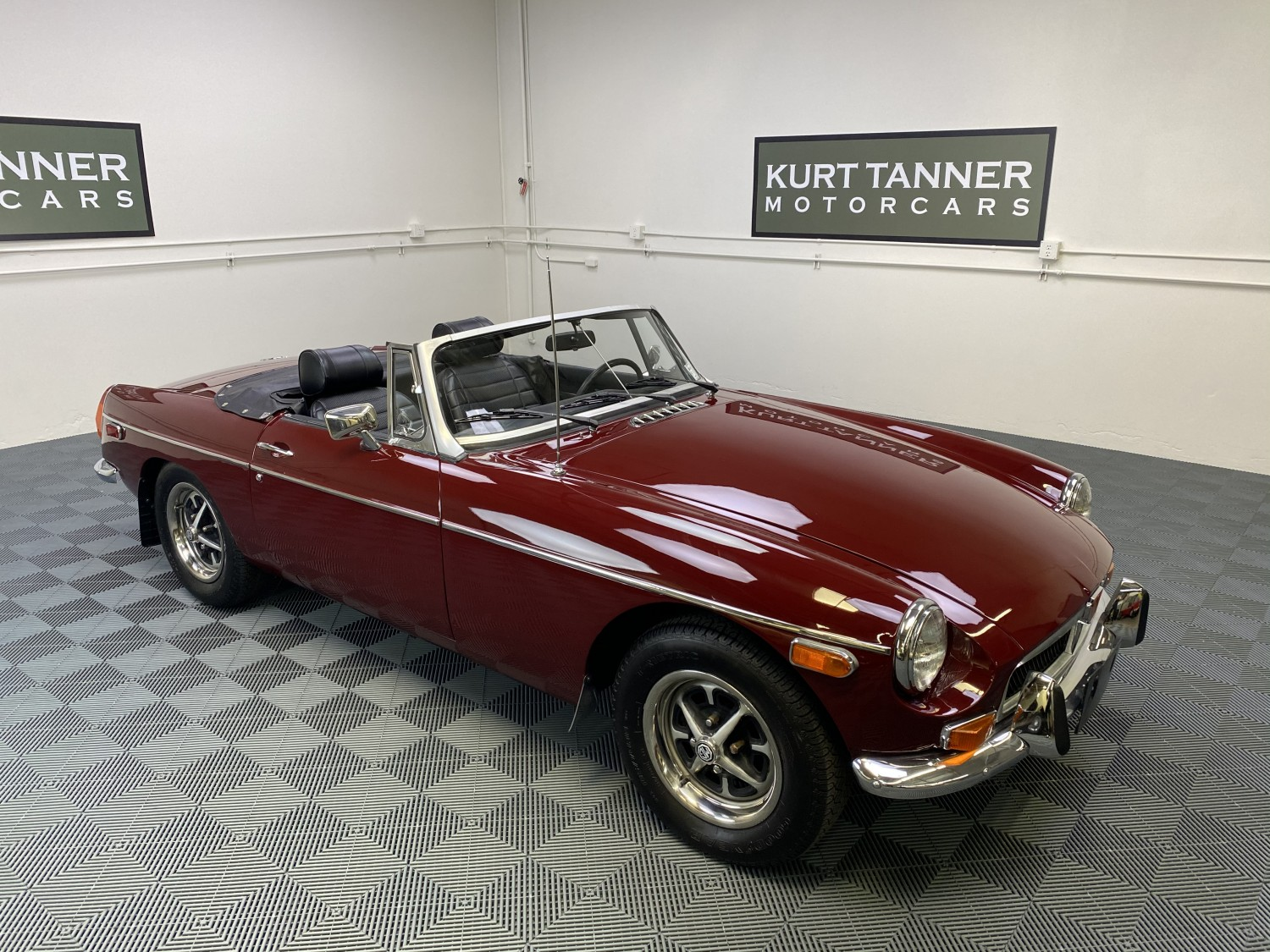 1974 MGB ROADSTER. DAMASK RED WITH BLACK TRIM, TOP, TOP BOOT, AND TONNEAU COVER. 4-SPEED, ROSTYLE WHEELS. EXCELLENT COSMETIC RESTORATION. REBUILT ENGINE. LOVELY CAR.