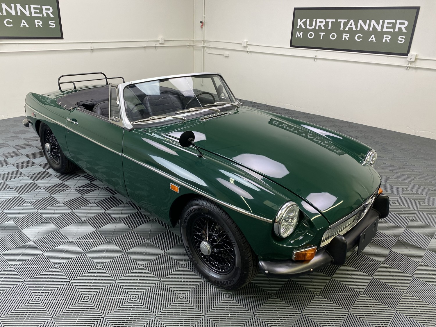 1969 MGB ROADSTER. BRITISH RACING GREEN WITH BLACK INTERIOR, TOP BOOT, BLACK HARDTOP WITH SUNROOF. 4-SPEED WITH OVERDRIVE, BLACK WIRE WHEELS, LUGGAGE RACK. NICE RUNNING AND DRIVING CAR.