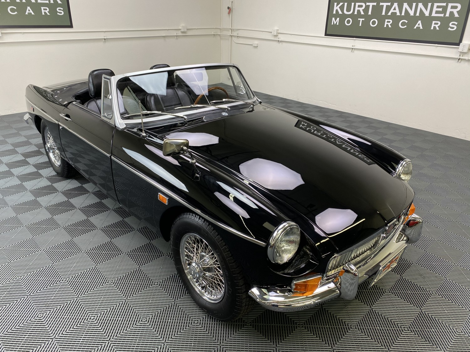 1969 MGB ROADSTER. BLACK WITH BLACK TRIM AND SOFT TOP, TOP BOOT, AND TONNEAU COVER. 4-SPEED. CHROME WIRE WHEELS. SUPERBLY RESTORED CAR FROM THE SAME FAMILY OF THE LAST 35 YEARS. 79,941 MILES.