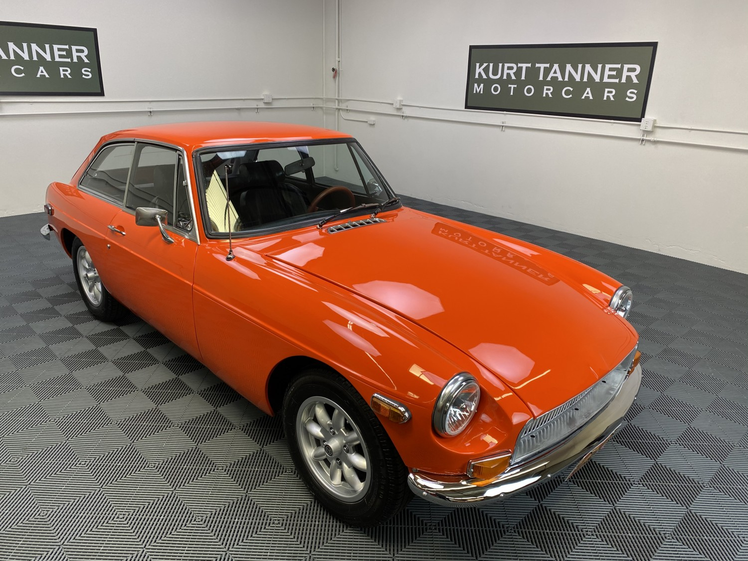 1970 MGB GT SPORTS COUPE. BLAZE ORANGE WITH BLACK TRIM. 4-SPEED WITH OVERDRIVE. MINILTE ALLOY WHEELS. SUPER COSMETIC RESTORATION.  EXCELLENT DRIVING CAR.